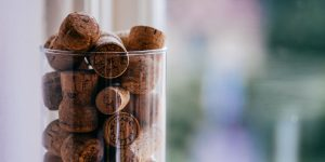 glass vase filled with wine corks